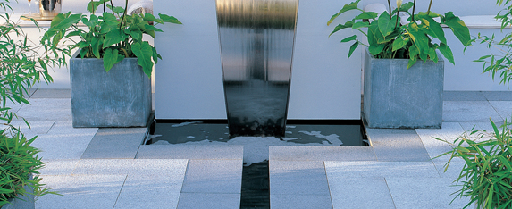 Water feature displayed in garden patio area.