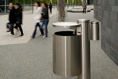 Geo litter bin with pedestrians walking by